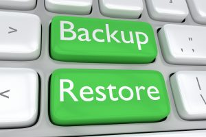 keyboard with 2 green keys 1 says backup the other says restore